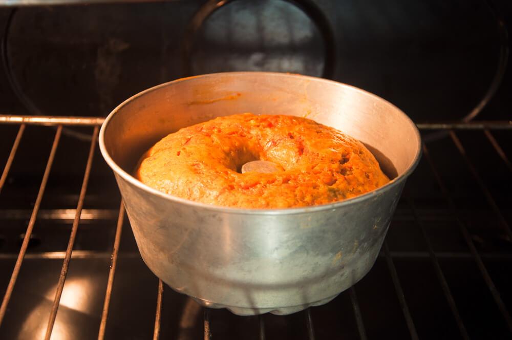 carrot cake baking in oven.