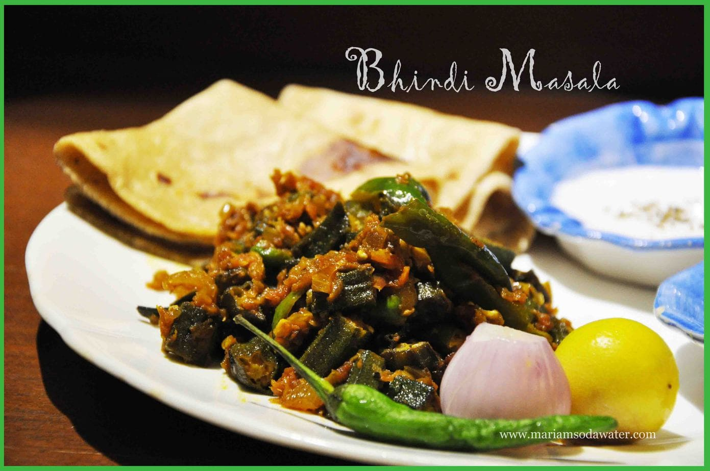 Bhindi served in plate with chapati and chutney served on the side.