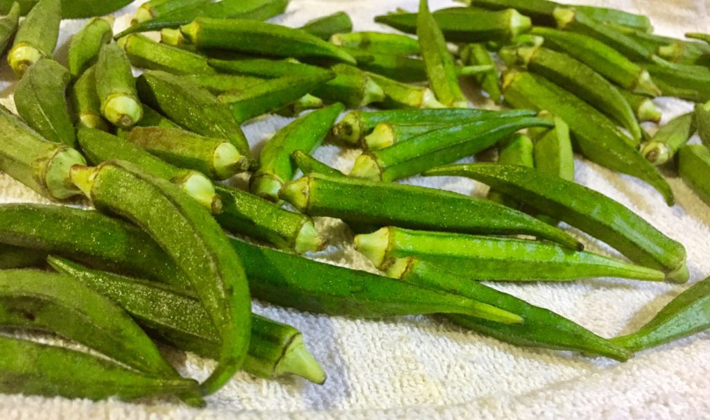 Wash and dry Okra Bhindi before cutting.