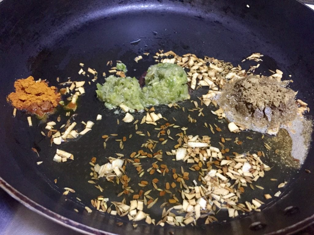 Fry spices in oil.