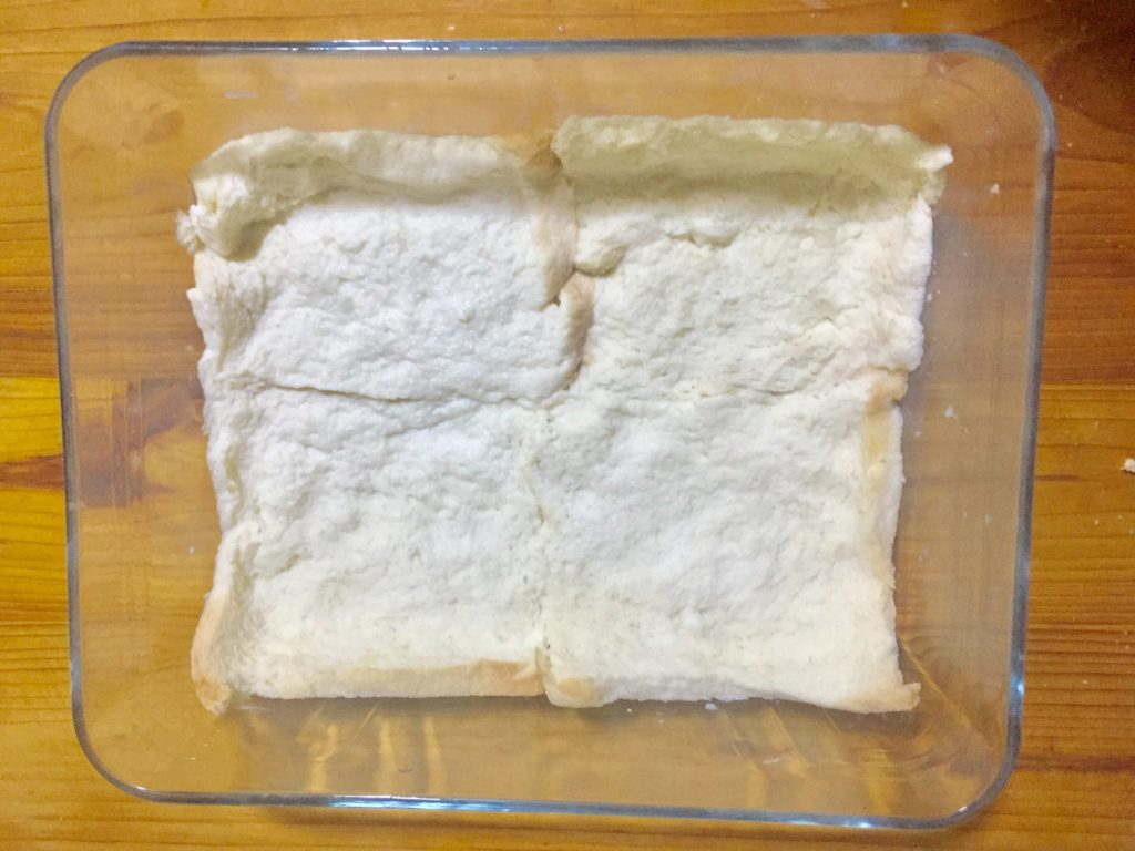 Set bread slices in baking dish.