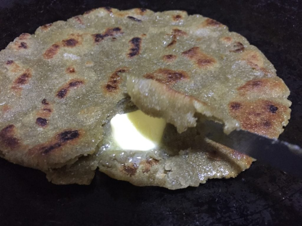 Bajra roti with butter and sugar.