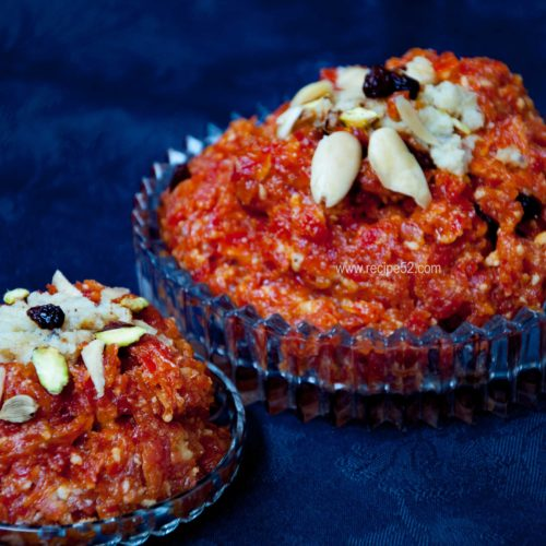 gajar ka halwa served in adish and garnished with nuts.