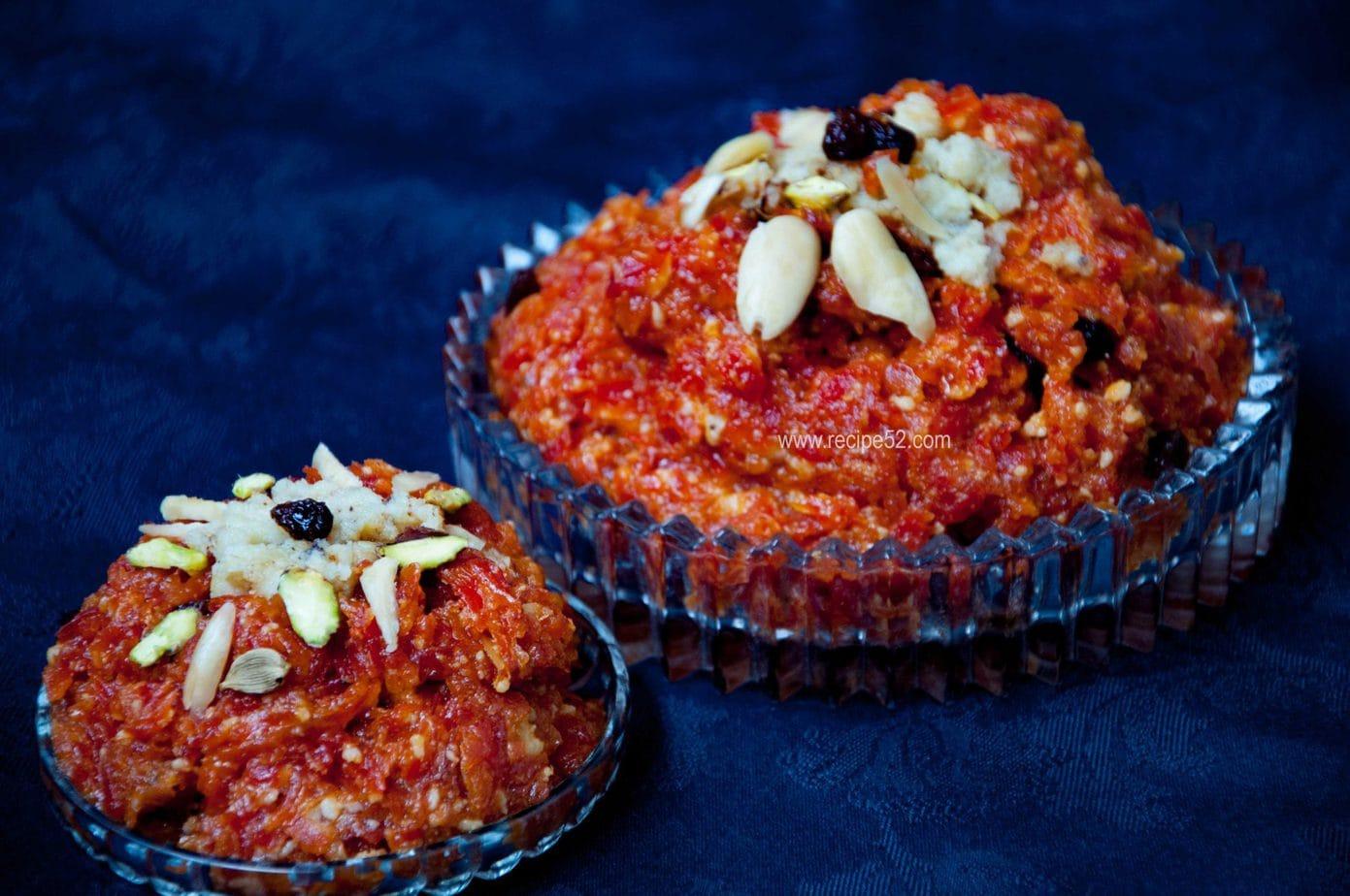 gajar ka halwa served in adish and garnished with nuts.