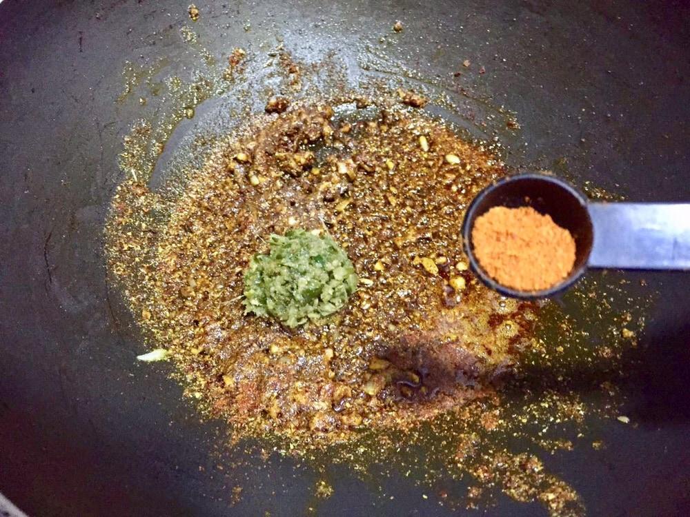 Add green chilli paste and red chilli powder.