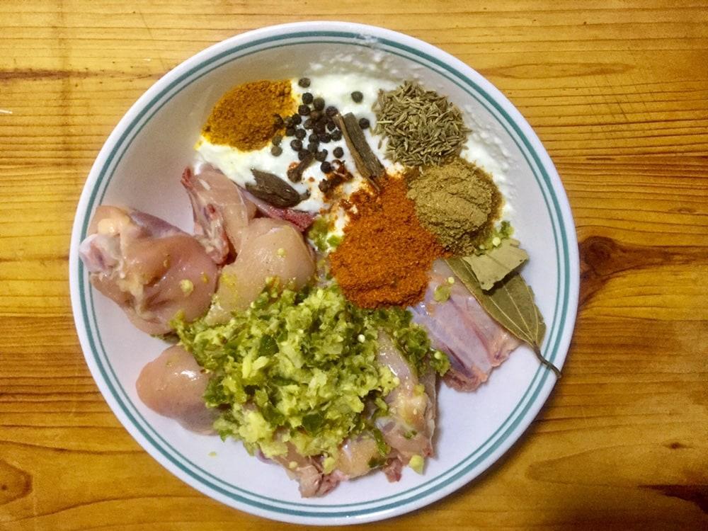Marinate chicken for Pakistani Chicken Biryani.
