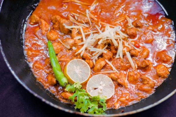 ginger chicken served in wok Close up.