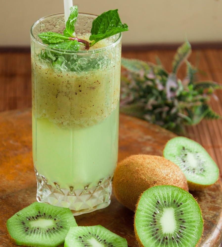 Kiwi juice served in tall glass.
