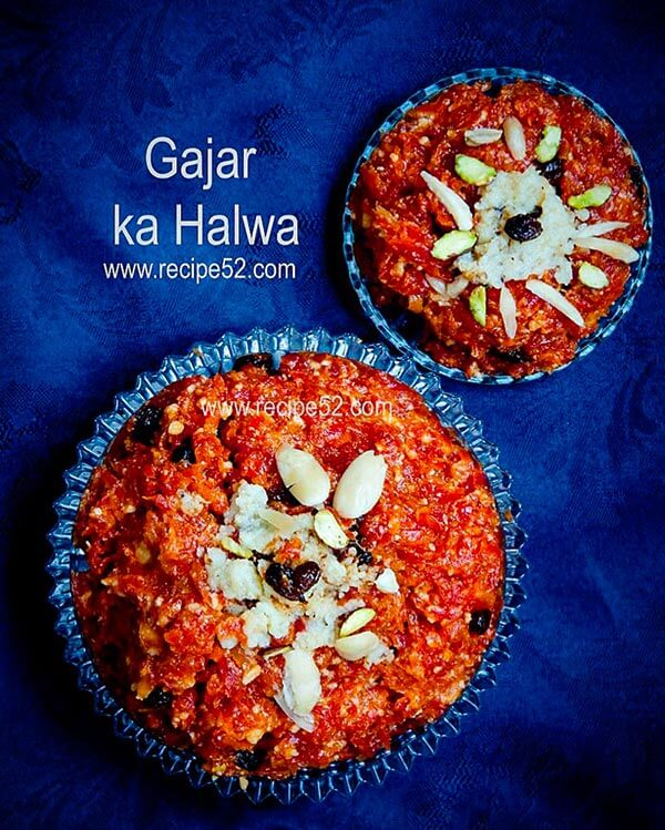 Gar halwa served in a plate with khoya and nuts garnished on top.