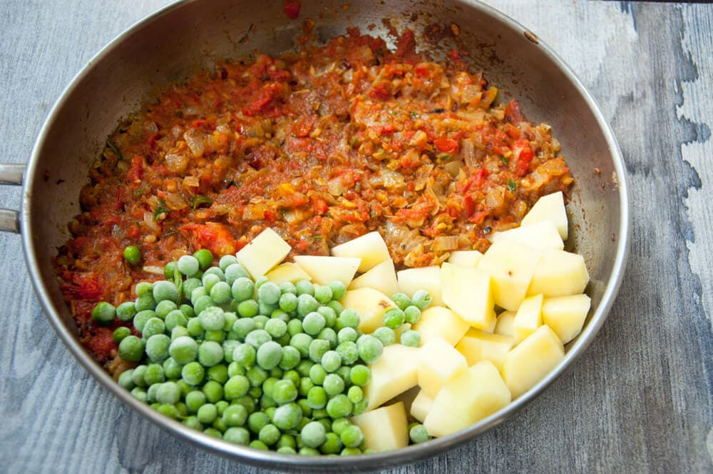 Add potato and peas to the gravy.
