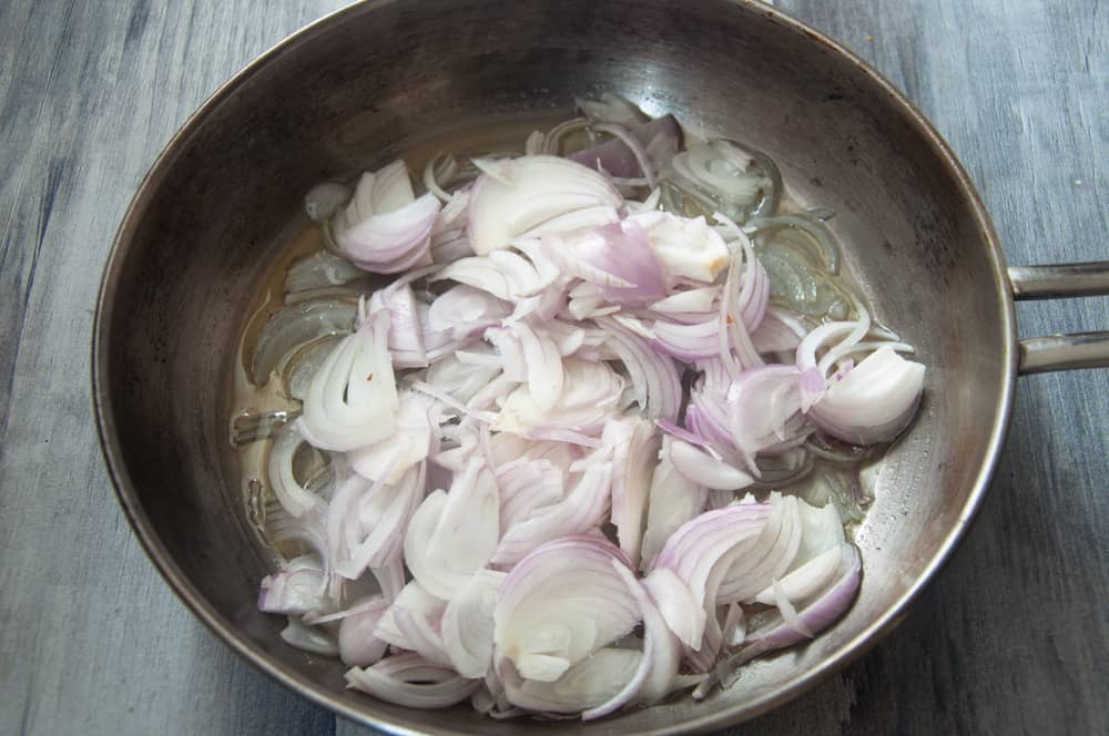 Fry sliced onions until golden brown.