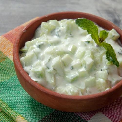 cucumber yogurt salad served in bowl.