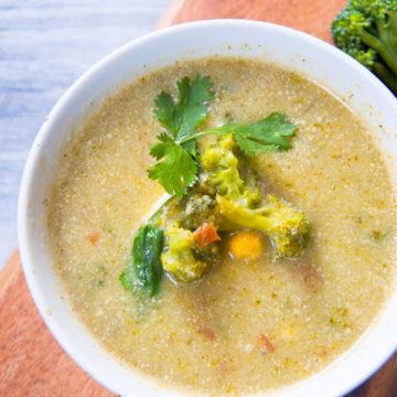 Broccoli potato soup served in bowl.