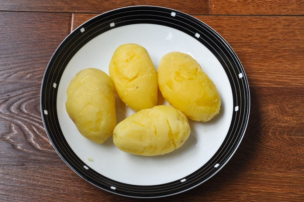 Boiled and peeled potatoes.