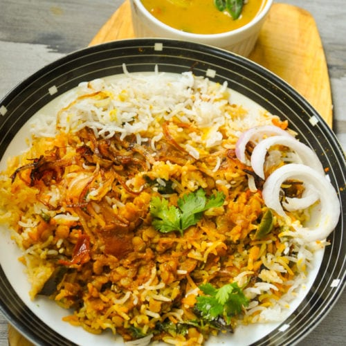 Daal Chawal Palidu served in a plate with palidu in a bowl.