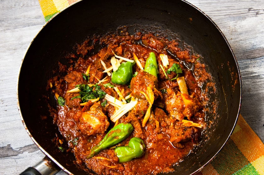 Top view of karahi gosht in a wok.