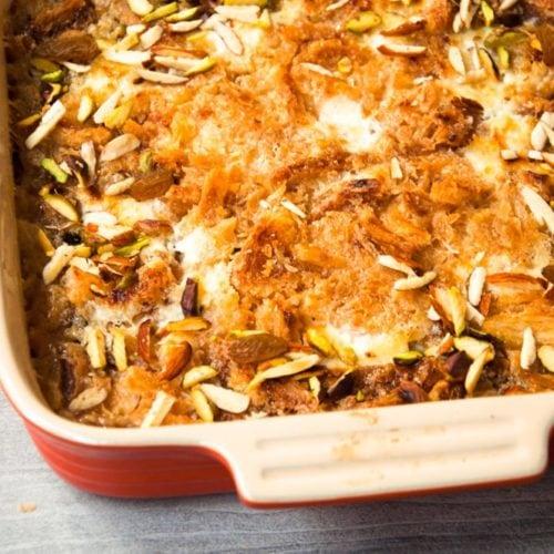 Freshly baked Om Ali in a casserole dish.