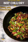 Beef chilli dry in a wok, ready to serve. The image has overlay text.