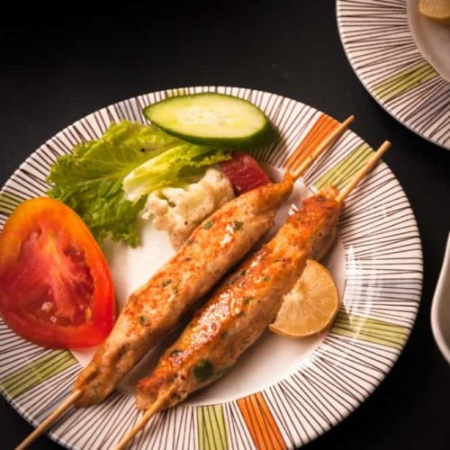 Chicken seekh kabab skewers served in a plate.