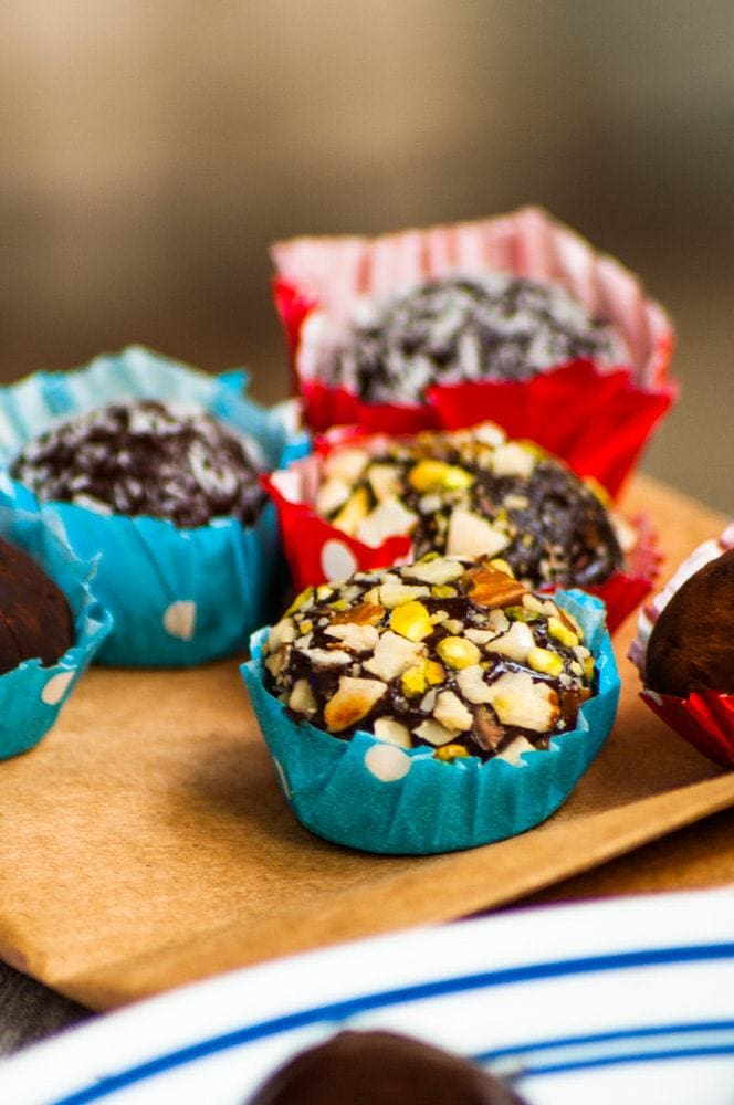 Different variations of Brigadeiro Chocolate truffles served in blue and red bon bon cup.