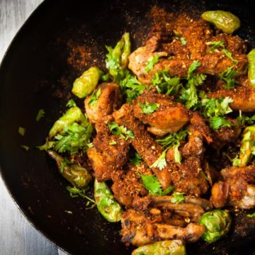 Tikka karahi in a wok, ready to be mixed with spices.
