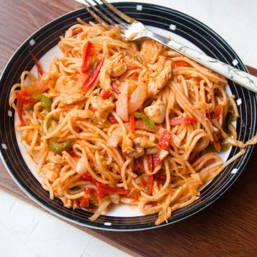 Pakistani noodles served in a plate .